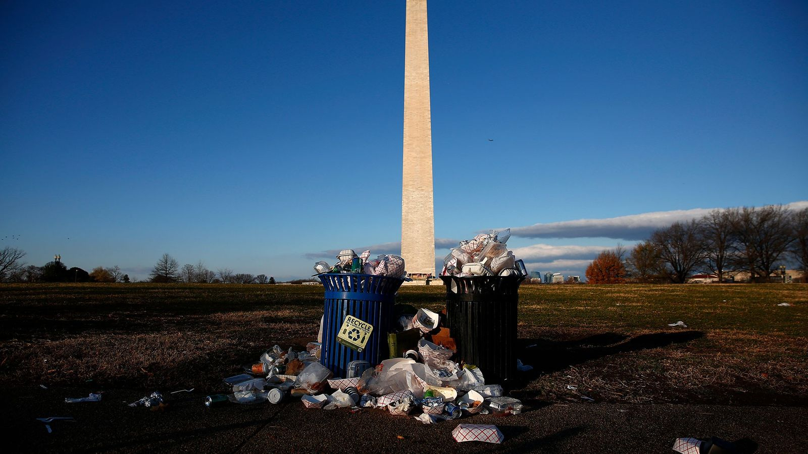 Trash accumulated along the National Mall near the Washington Monument due to a partial shutdown of ...