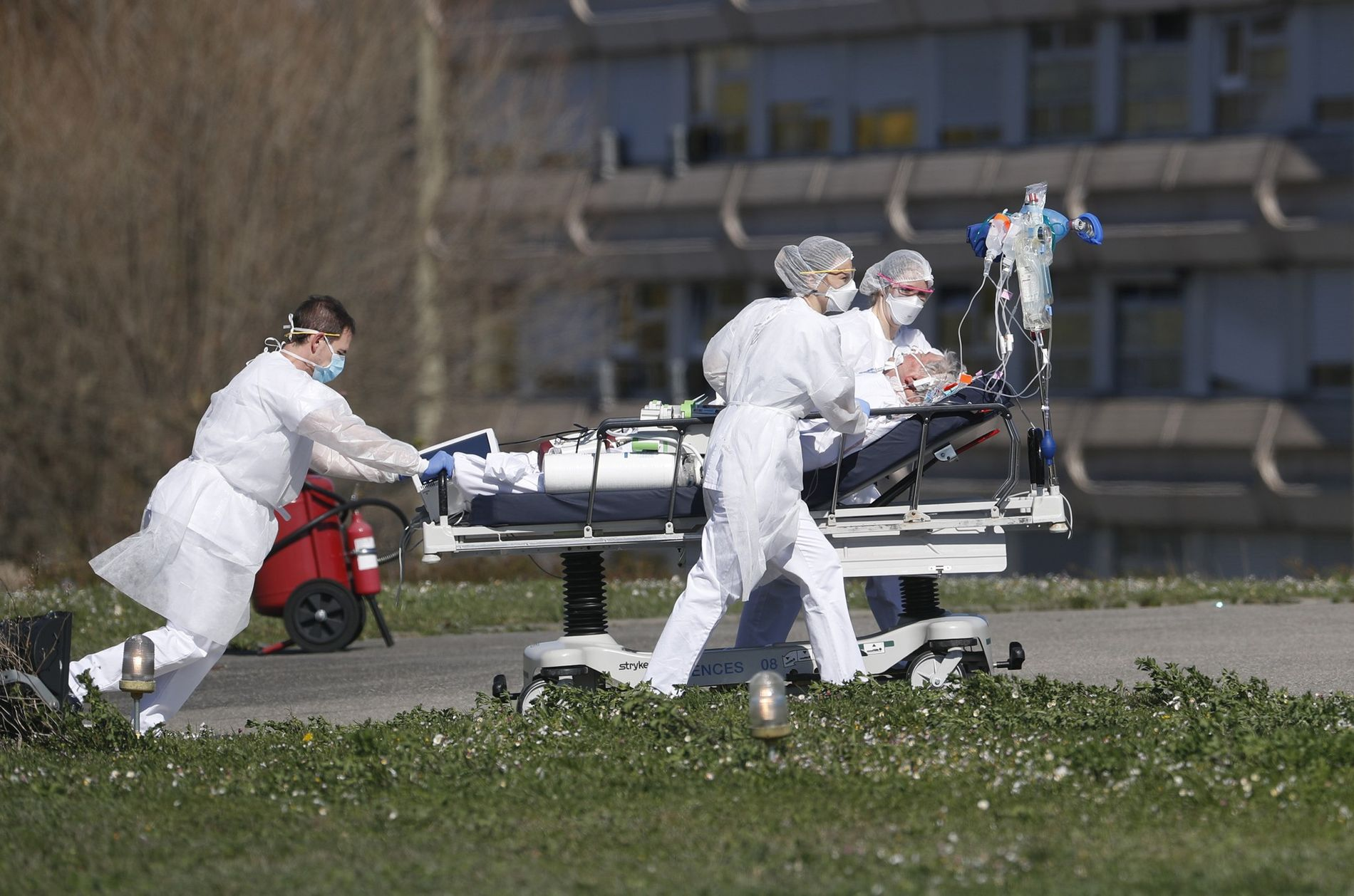 A victim of the Covid-19 virus is evacuated from the Mulhouse civil hospital, eastern France, Monday ...