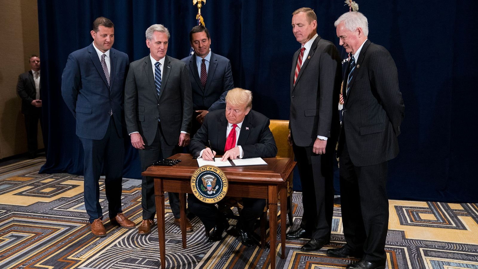 "President Donald Trump signs a presidential memorandum to ""minimize unnecessary regulatory burdens"" on October 19, 2018. ..."