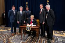 "President Donald Trump signs a presidential memorandum to ""minimize unnecessary regulatory burdens"" on October 19, 2018. ..."