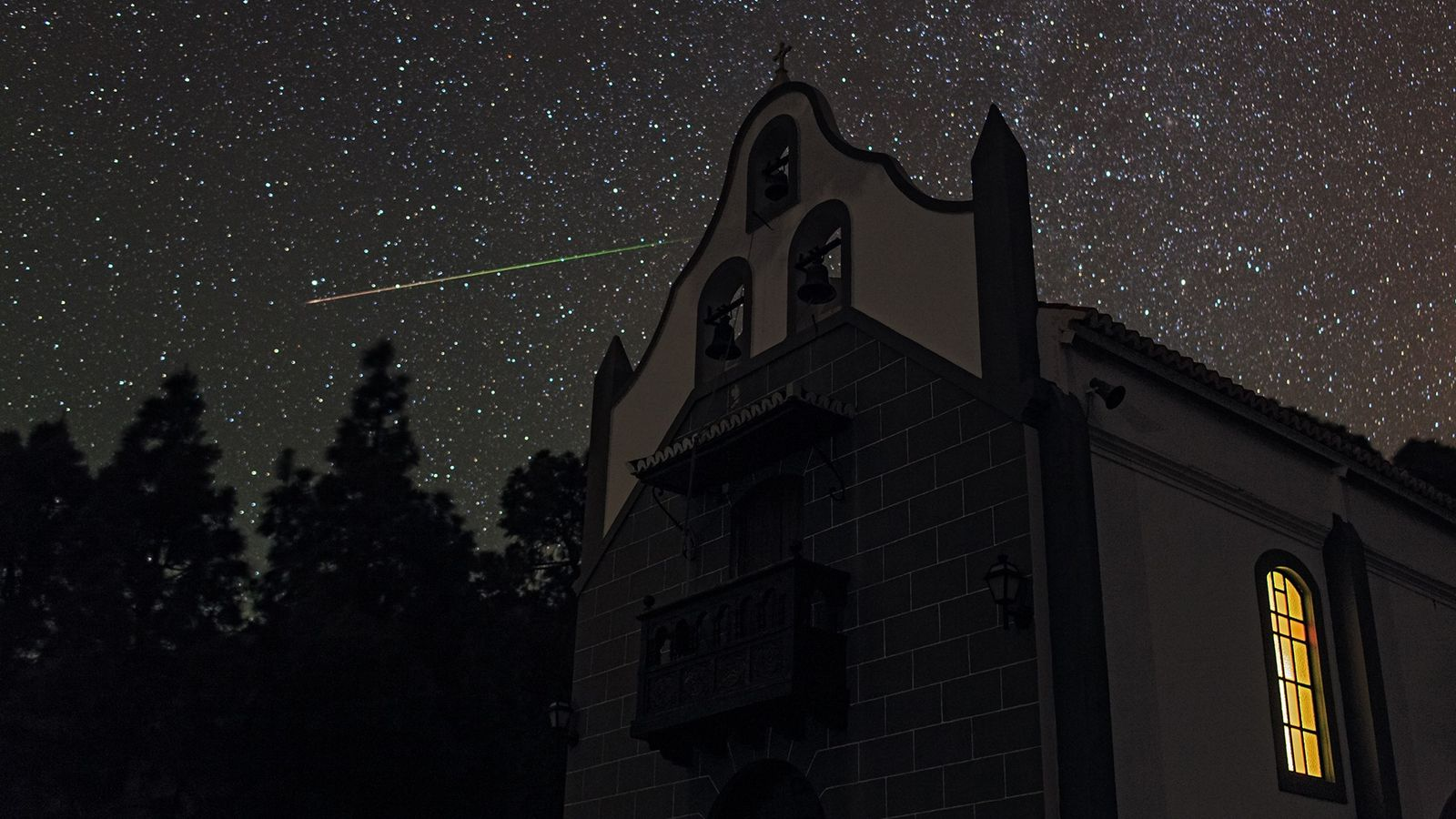 A meteor streaks through the constellation Ursa Minor, the little bear, as seen from La Palma ...