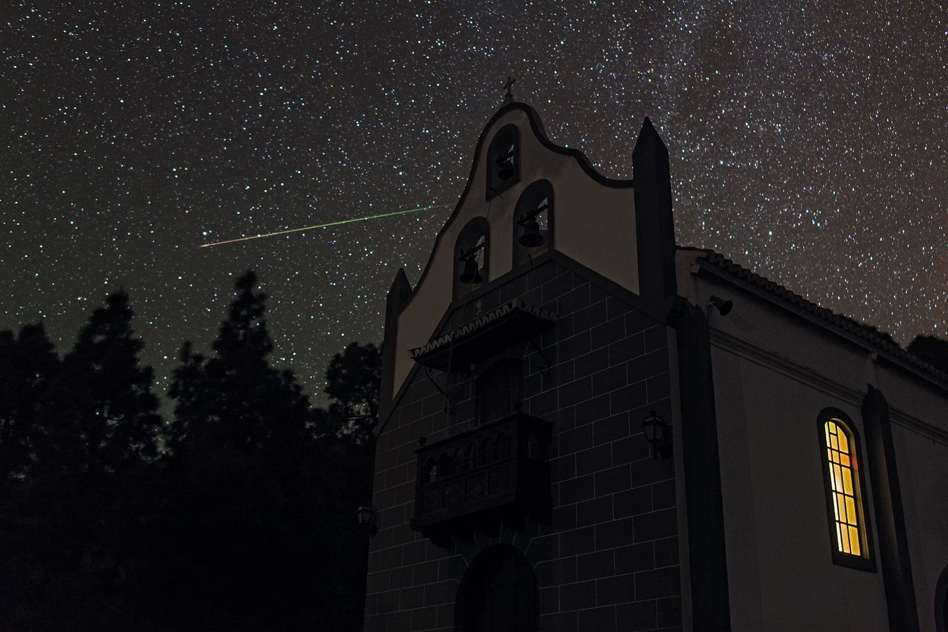 A meteor streaks through the constellation Ursa Minor, the little bear, as seen from La Palma ...
