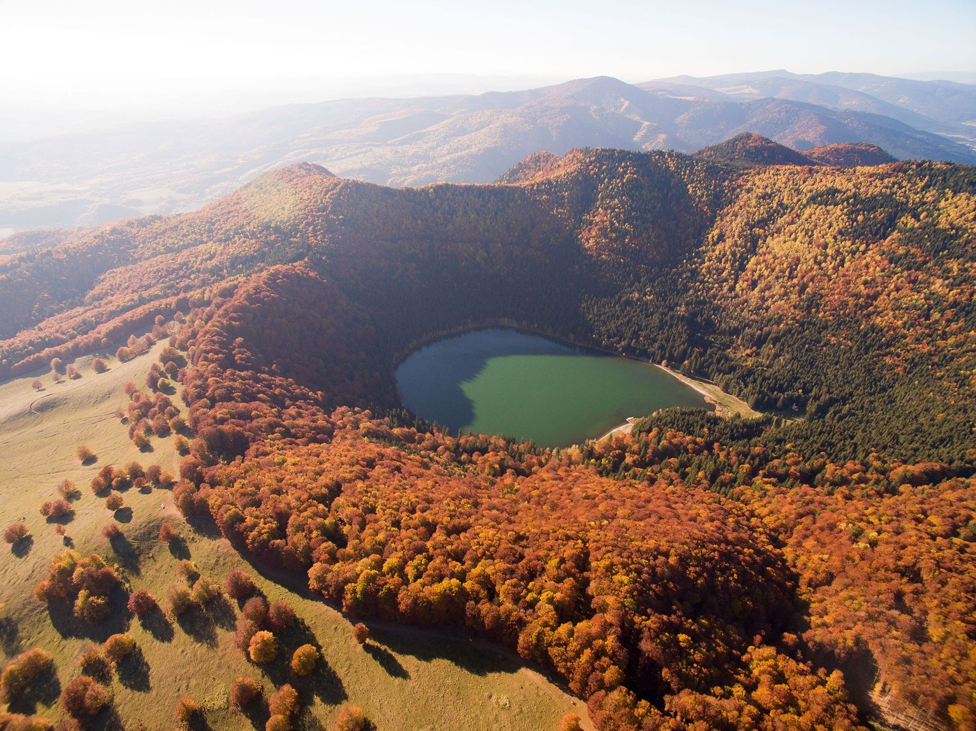 Saint Anne Lake is nestled in a crater of Romania's Ciomadul volcano, which last exploded some ...