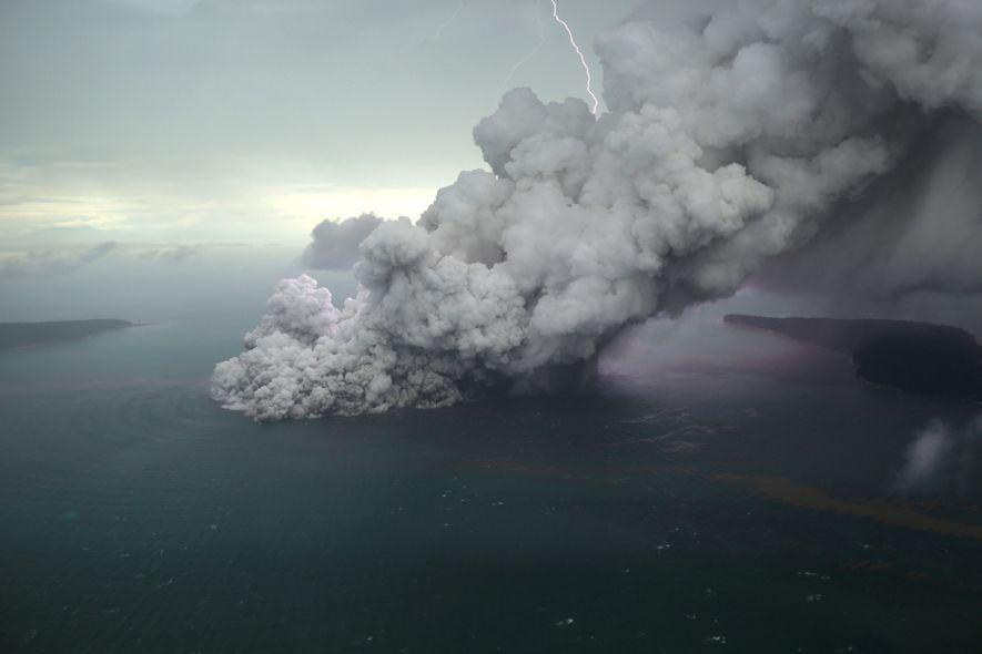 Billowing clouds of vaporised water shroud Anak Krakatau at the start of the lengthy volcanic thunderstorm ...