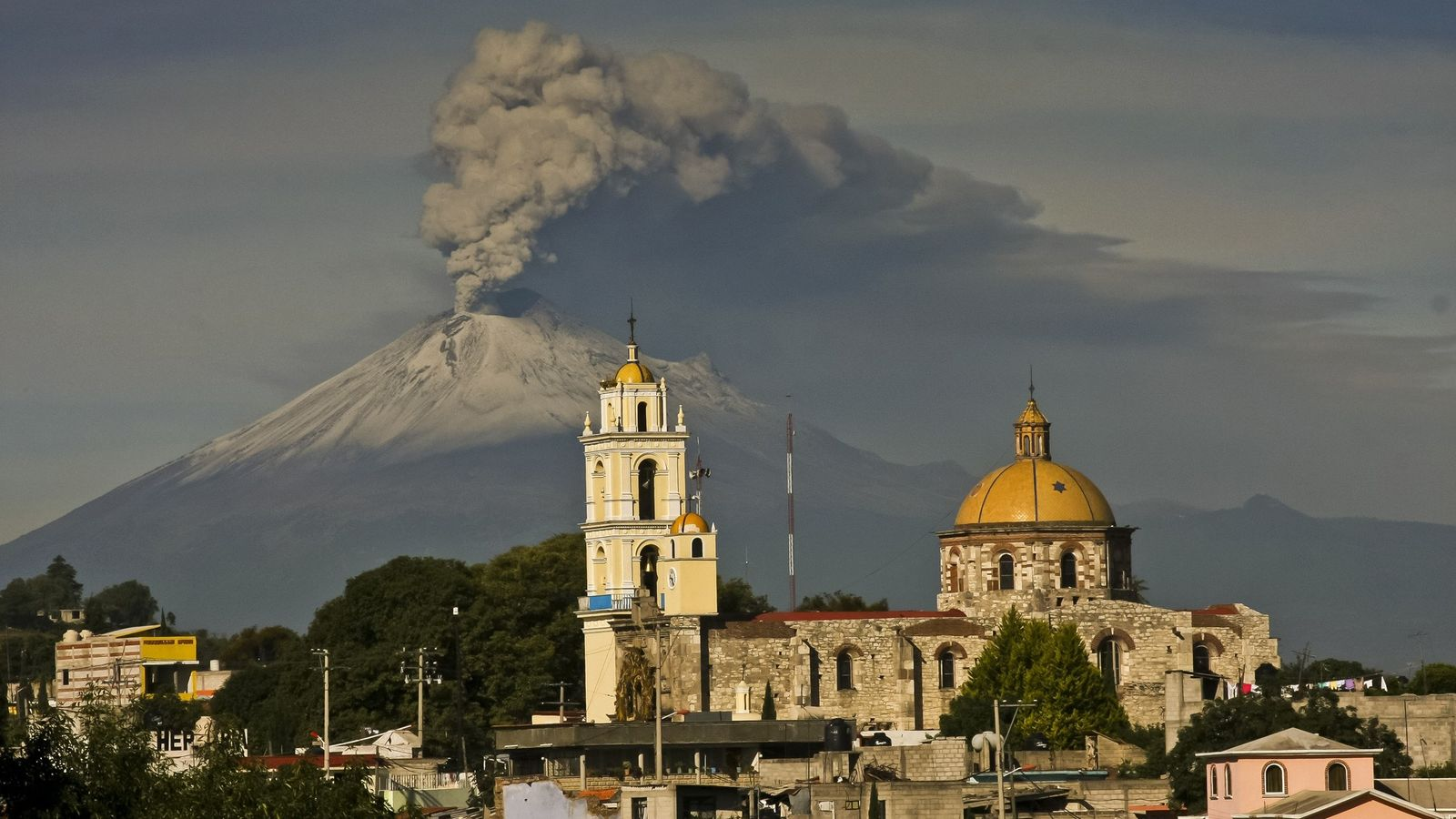 Ash spews from Mexico's Popocatépetl volcano in July 2013. The peak is part of the Trans-Mexican ...