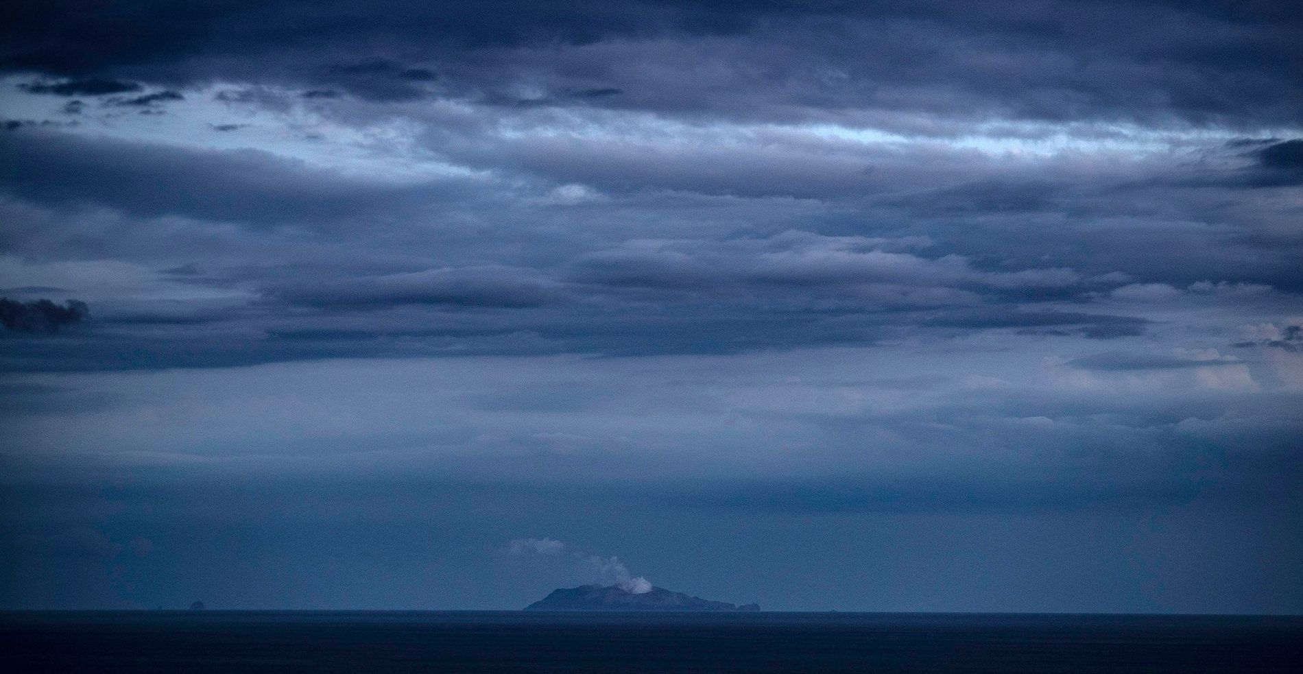 An ash plume rises from the active volcano on Whakaari/White Island in New Zealand on December ...
