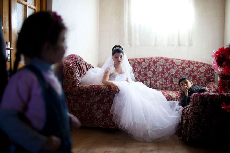 A 17-year-old Georgian-Azeri bride in the Kakheti Region waits for the groom to arrive on their …