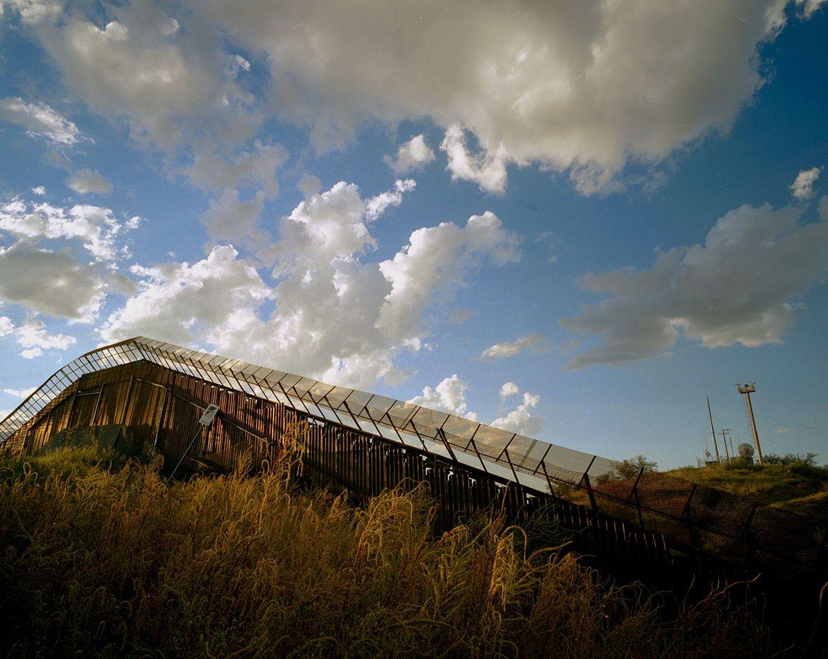 A border fence separates Nogales, Arizona, and Nogales, Mexico.