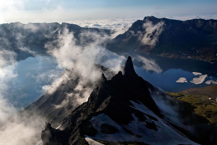 Clouds drift over the peak of Mount Paektu, as seen from North Korea's Ryanggang Province in ...