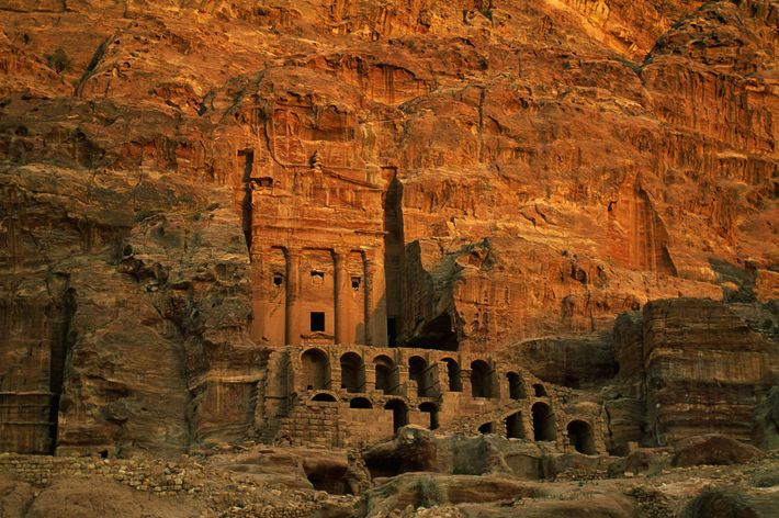 Carved into rose-colored rock in Jordan, the ancient city of Petra shows architectural influences from Greece, ...