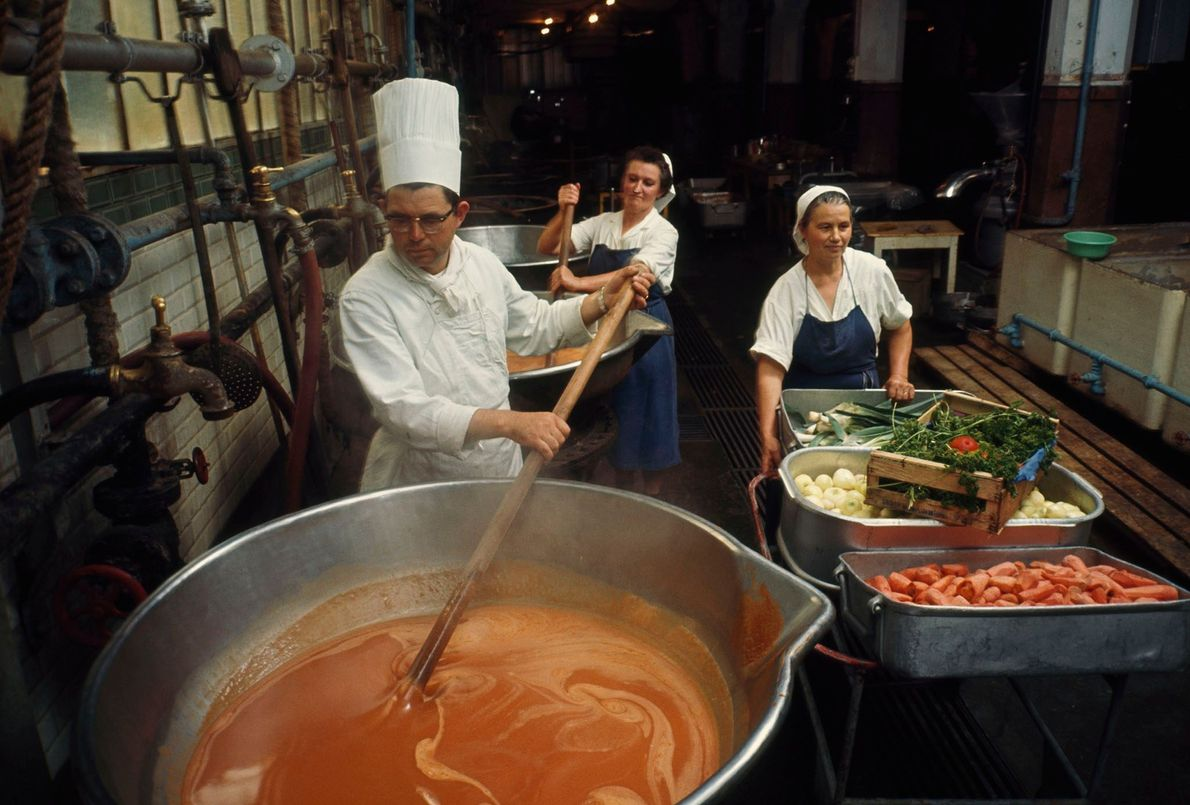 A chef at a factory in Nantes, France, stirs a giant vat of fish sauce, which ...