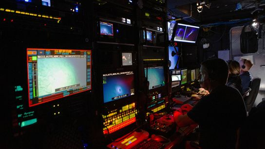 Inside the control room, crewmembers pilot remotely-operated vehicles (ROVs) and keep round-the-clock vigil in four-hour shifts.