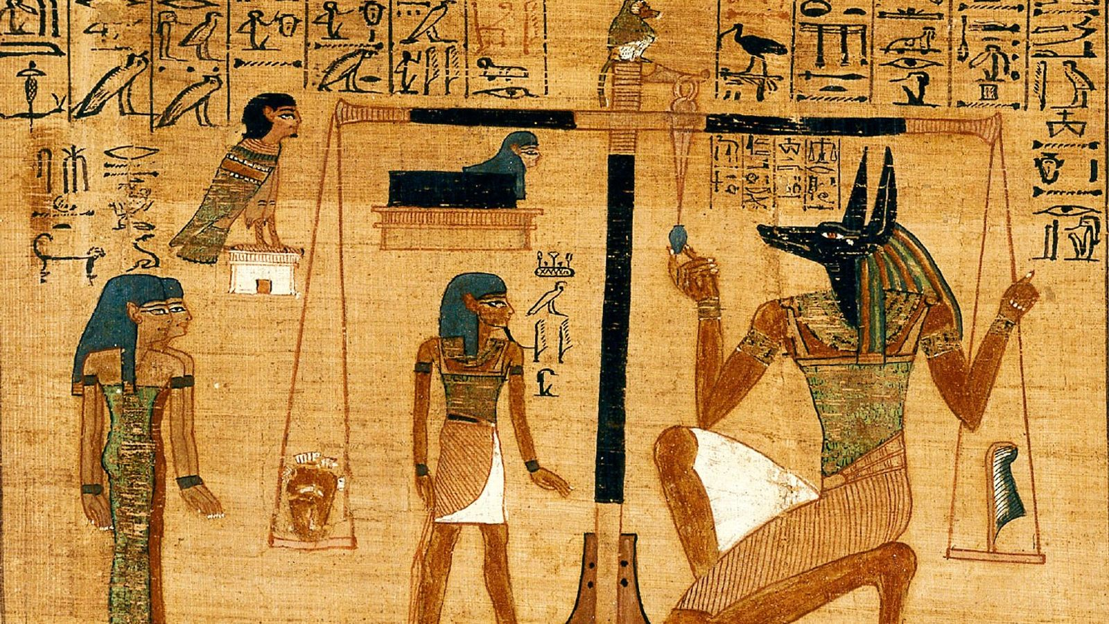 Ani's soul, represented by a bird with a human head, observes as Anubis weighs Ani's heart ...