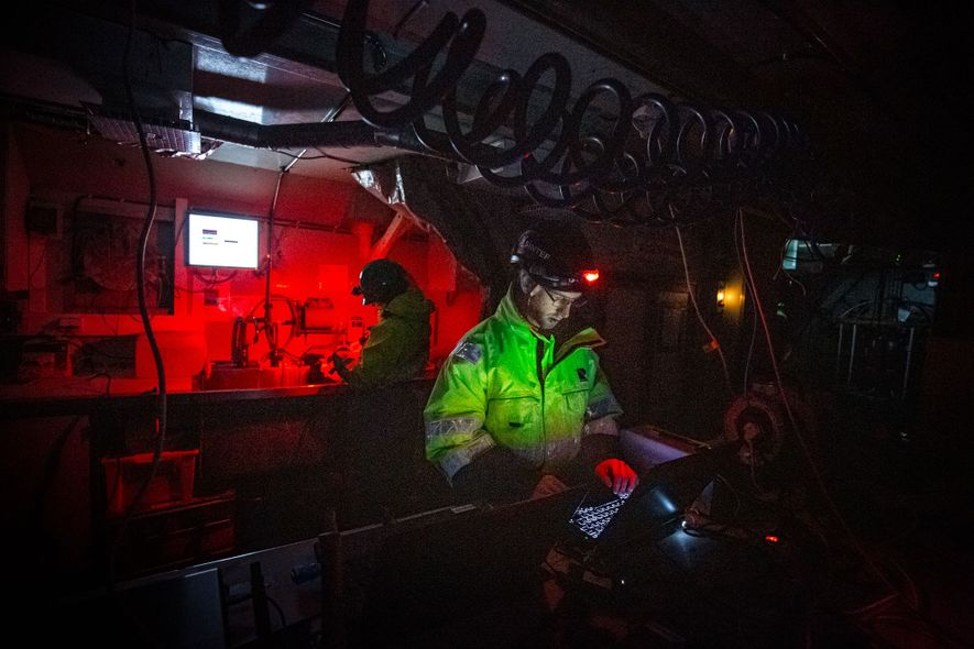 Emlyn Davies watches the data come in on an array of laptops aboard the Helmer Hanssen. ...