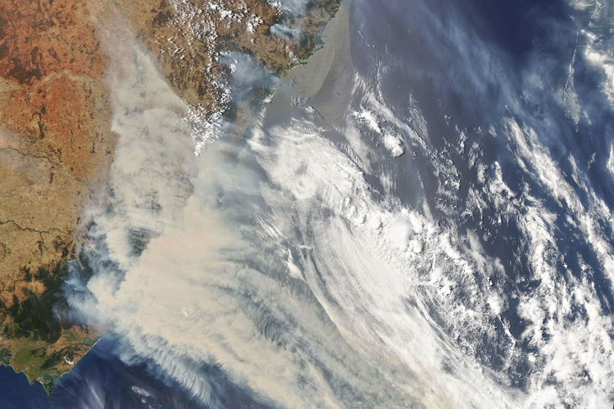 A NASA satellite image shows smoke and clouds trailing from Australia's massive fires.