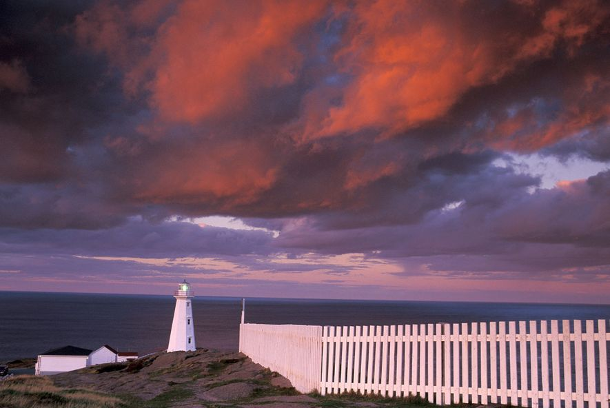 Colourful clouds roll over the Cape Spear National History Site in Newfoundland, Canada.