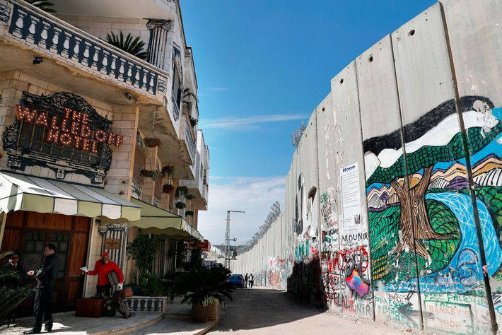 The British artist Banksy opened the Walled Off hotel in Bethlehem next to the wall that ...