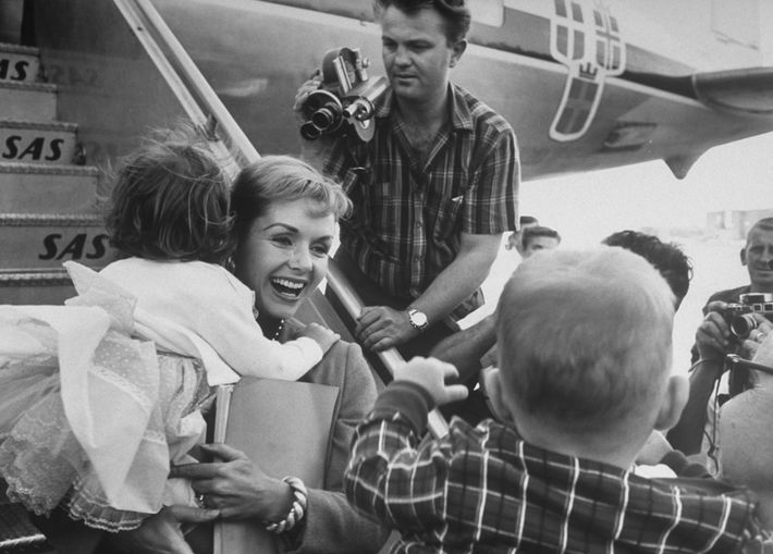 While on the tarmac with her daughter Carrie, actress Debbie Reynolds is asked by reporters whether ...
