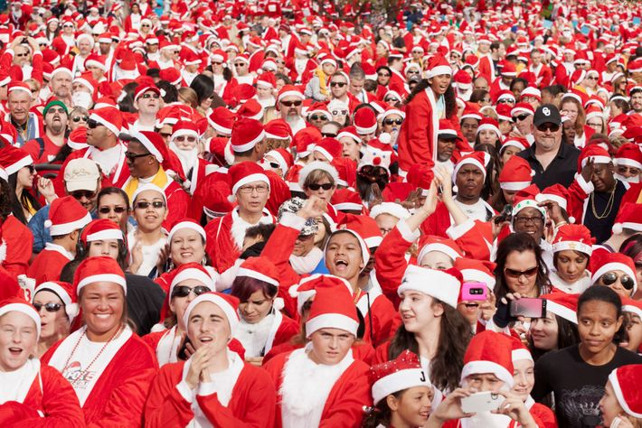 """Before the early morning starter's pistol, participants in the 2012 Las Vegas """"Great Santa Run""""—who all ..."""