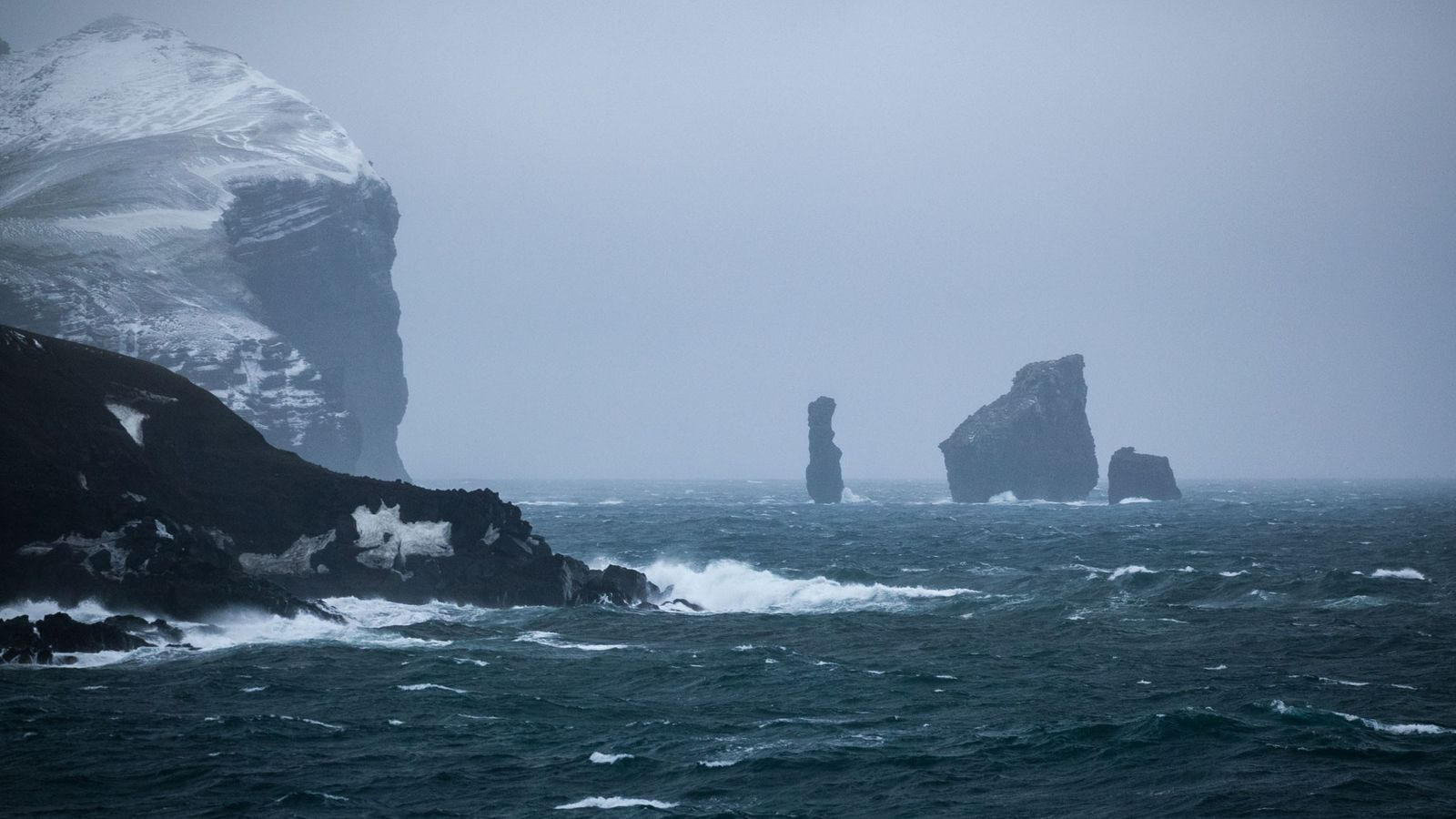 The rock formation known as the Sewing-Machine Needles, visible from miles away by ship, marks the ...