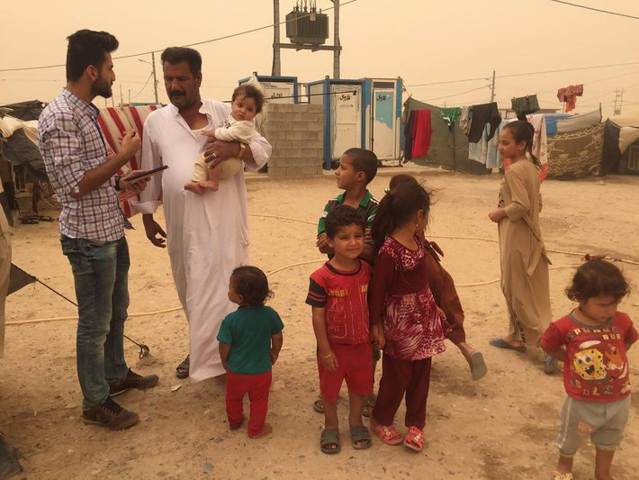 A humanitarian worker collects information in Iraq. Something has simple as a survey can be a ...