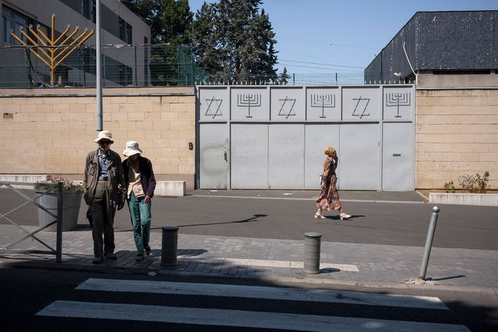 A closed metal gate marks the entrance to the Great Synagogue of Sarcelles in France.