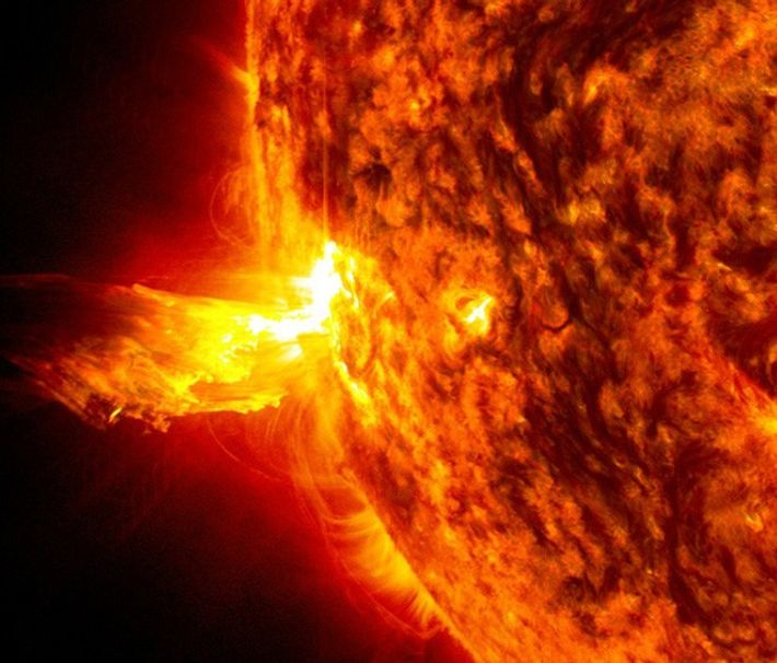 Solar storms can include solar flares, captured in an image here, wherein high energy particles are ...