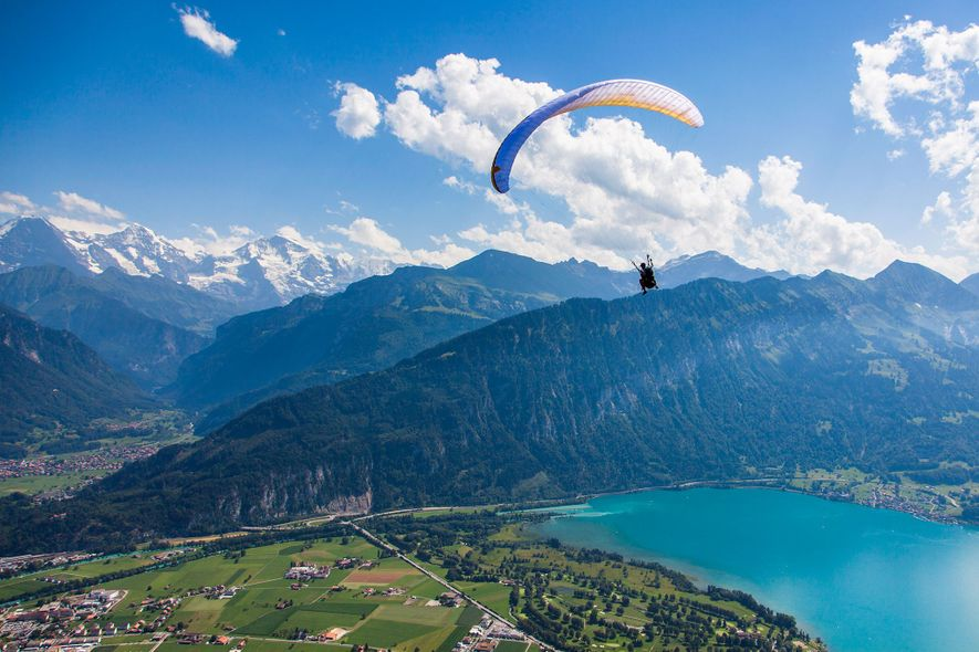 Seek new heights paragliding over Interlaken, Switzerland.