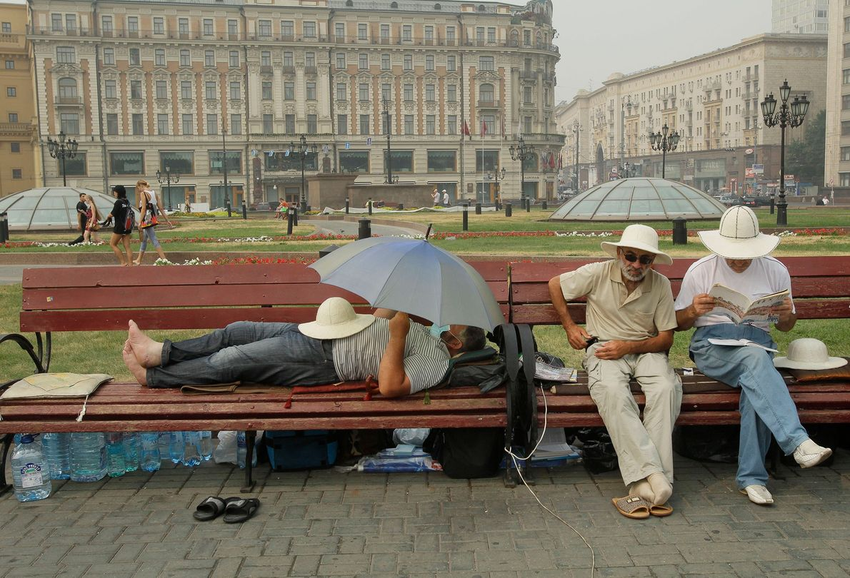 In this photograph from August 9, 2010, people rest on the Manezhaya Square just outside the ...