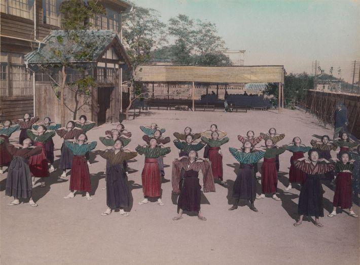 Middle school girls perform calisthenics in Japan.