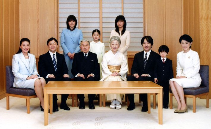In this official photo, Japan's Emperor Akihito, center left, and Empress Michiko, center right, smile to ...