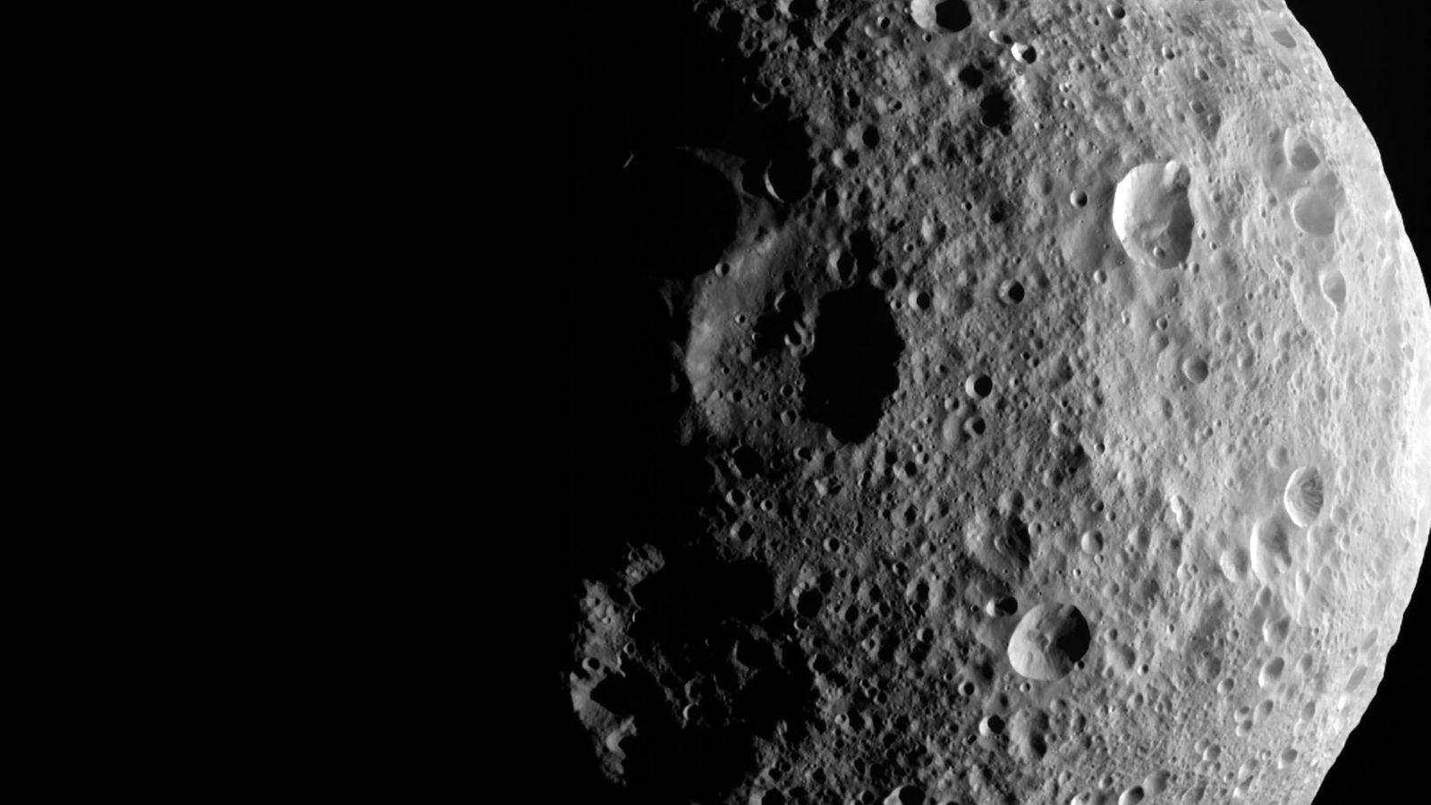 The shadowy outlines of terrain in the asteroid Vesta's northern region are visible in this image ...