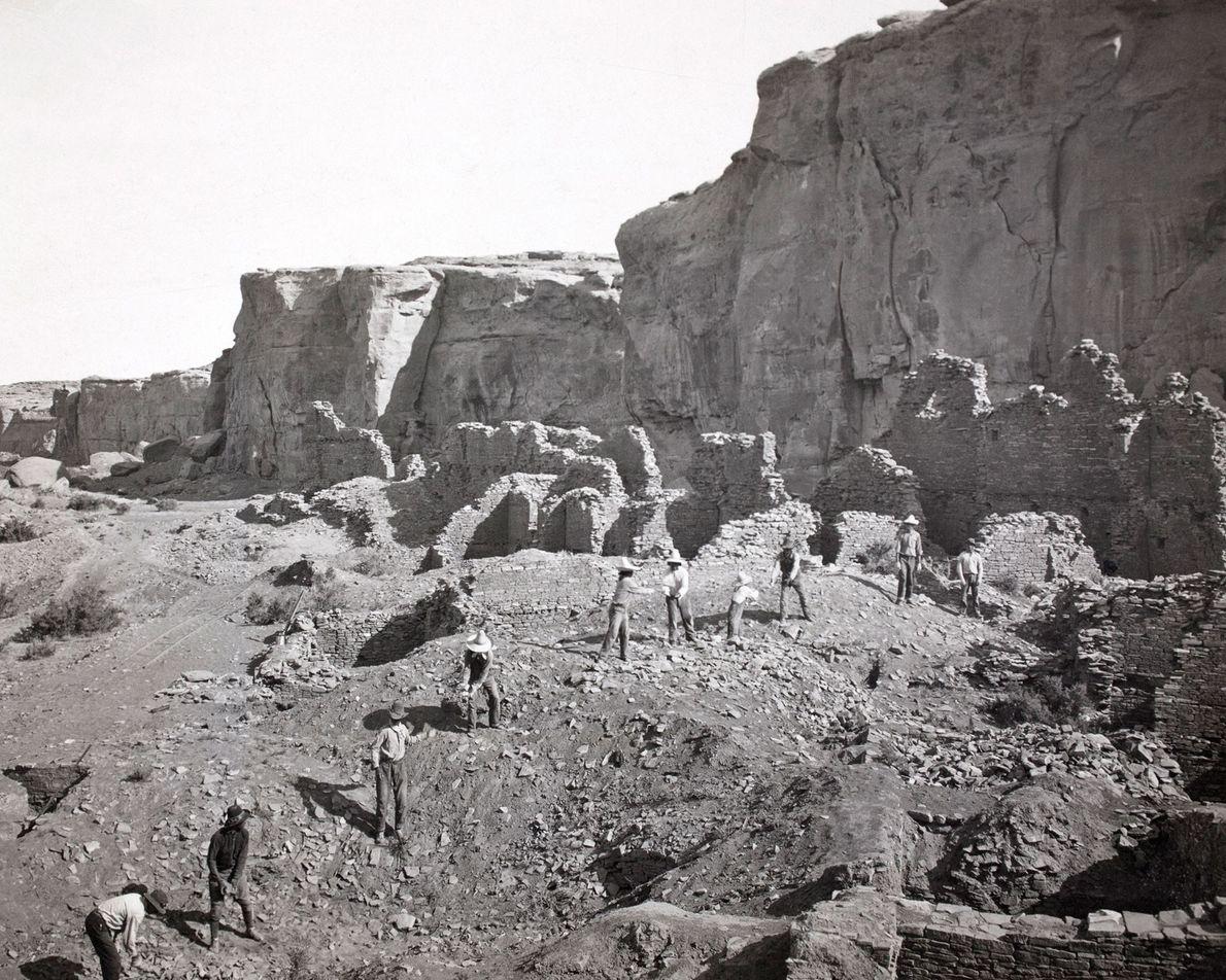 Archeologists remove unstable stones before excavating Pueblo Bonito.