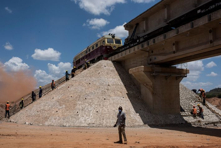 In Voi, men work on the new standard-gauge rail line that will stretch from the port ...