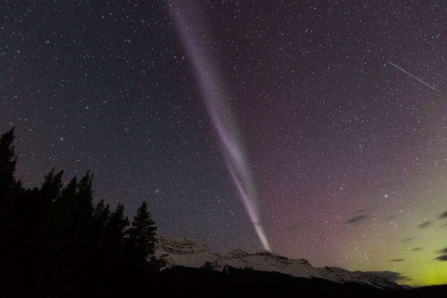 The aurora known as Steve is seen over Lake Minnewanka in Alberta.