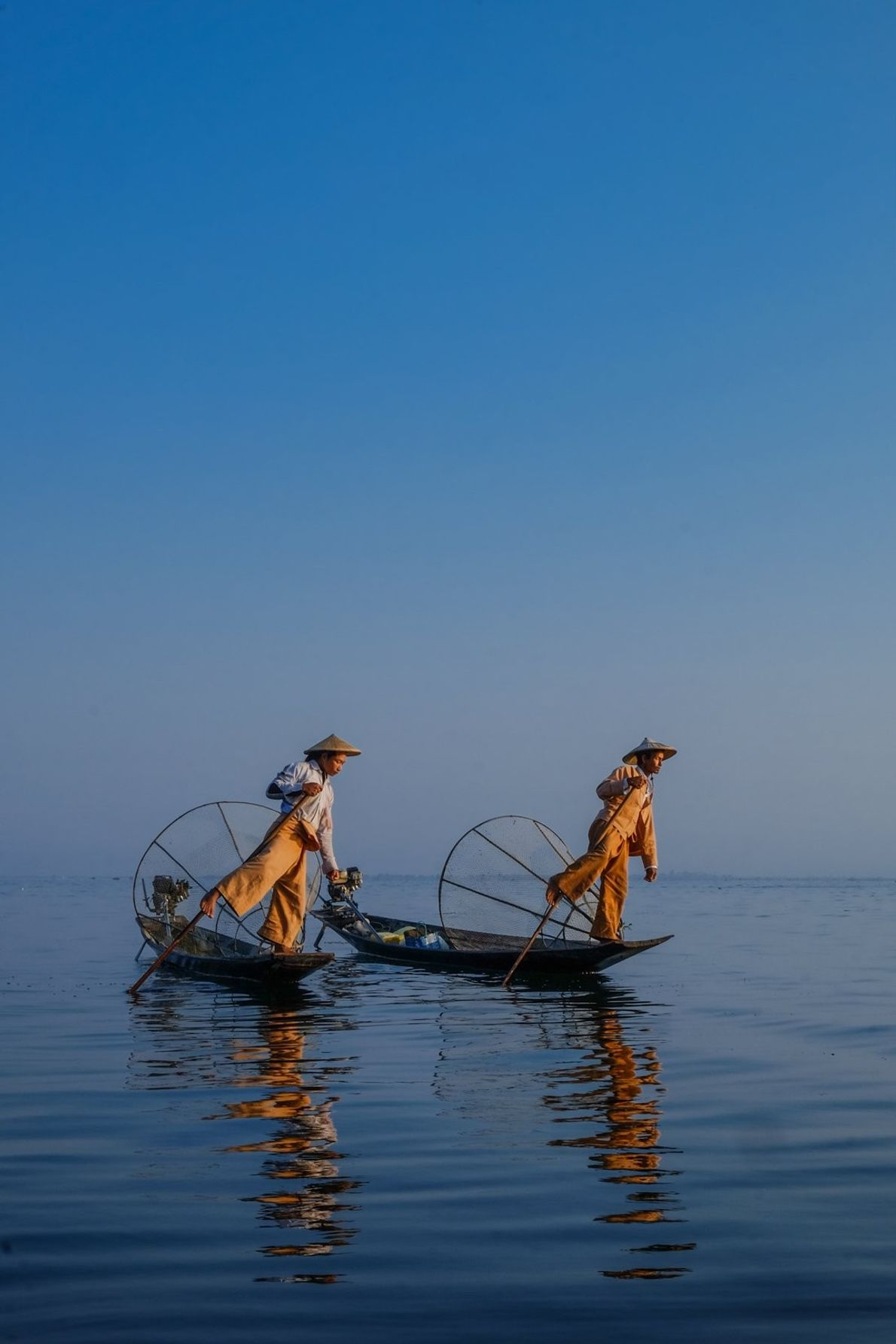 """It's been a long-time dream to photograph the leg rowing fisherman in Inle Lake, Myanmar. """"Early ..."""