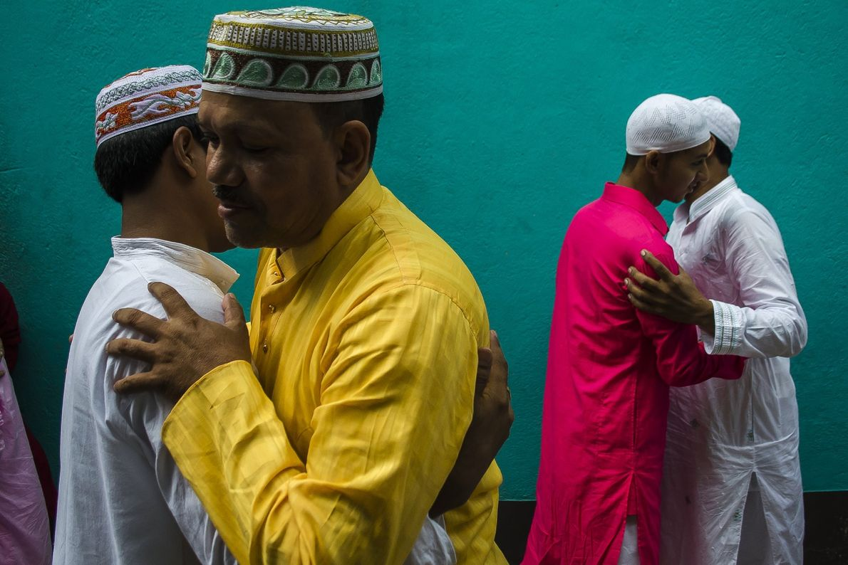 Your Shot photographer Ayanava Sil documented men as they hug each other after morning prayers during ...