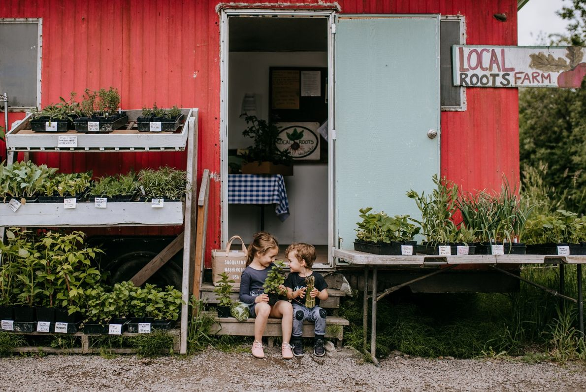 """A fun morning at the farmstand with these two,"" writes Your Shot photographer Jess Buttermore. ""This ..."