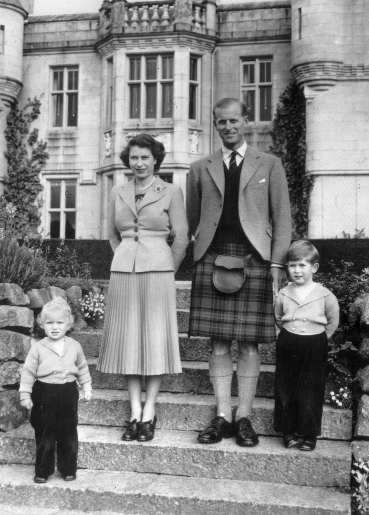 Queen Elizabeth II and Prince Philip, Duke of Edinburgh, with their two young children, Princess Anne ...