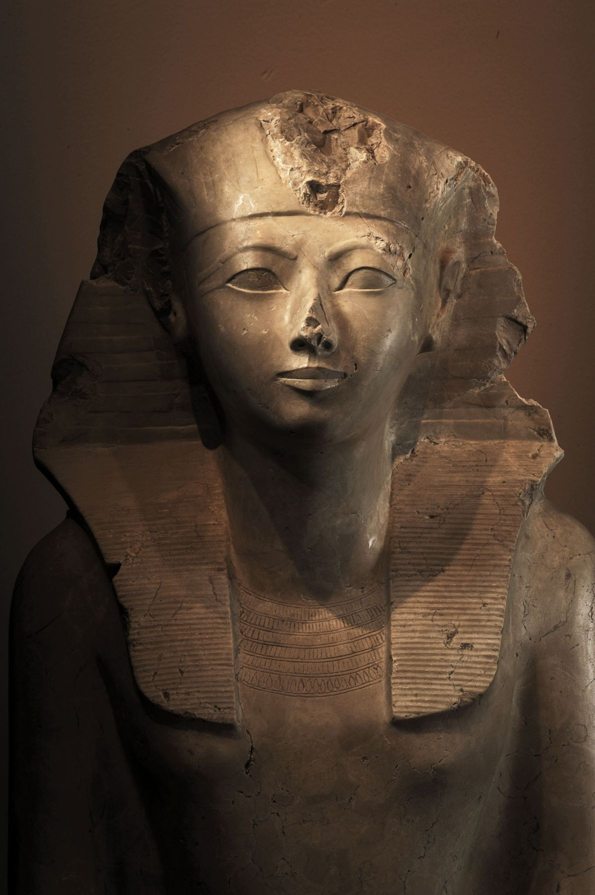 A limestone statue of Queen Hatshepsut depicts her wearing the regalia of a king, something she ...