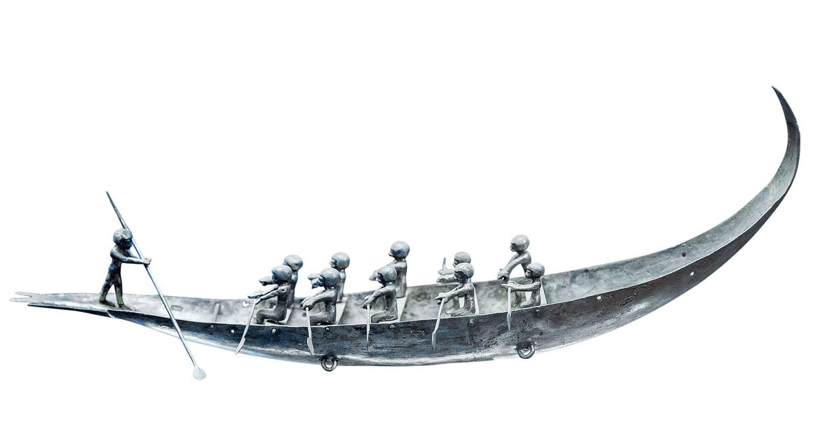 Depicting oarsmen and a helmsman, this miniature silver boat is one of a pair of vessels ...
