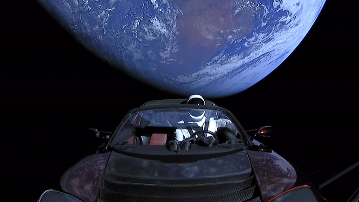 A Tesla roadster launched from the Falcon Heavy rocket with a dummy driver named 'Starman' heads ...
