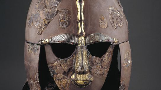 This extraordinary helmet was buried with its Anglo-Saxon owner, an elite warrior or possibly even a ...