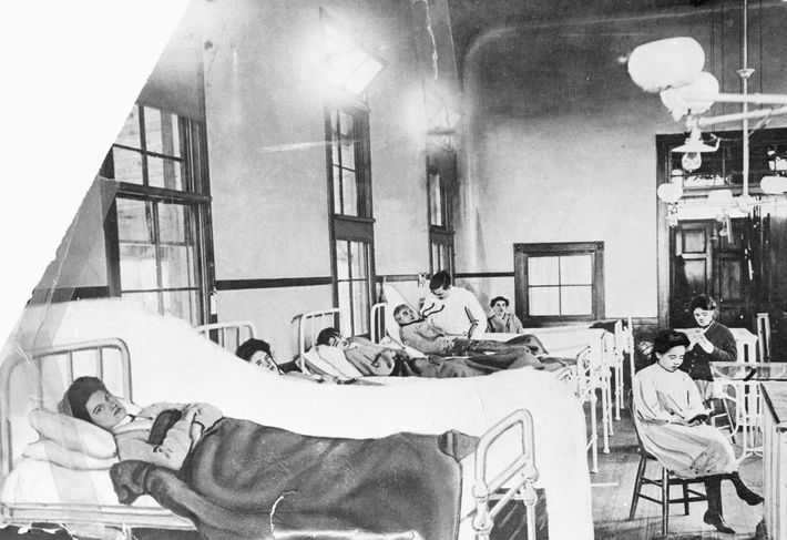 Mary Mallon (foreground) didn't show symptoms of typhoid, but spread the disease while working as a ...