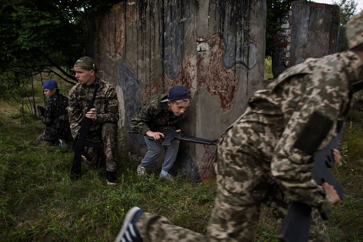 Ukrainian children take part in a military war simulation exercise at RANGER camp. The patriotic military ...