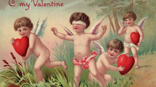 An antique Valentine's Day postcard. Cupid, the Roman god of love and a common figure of ...