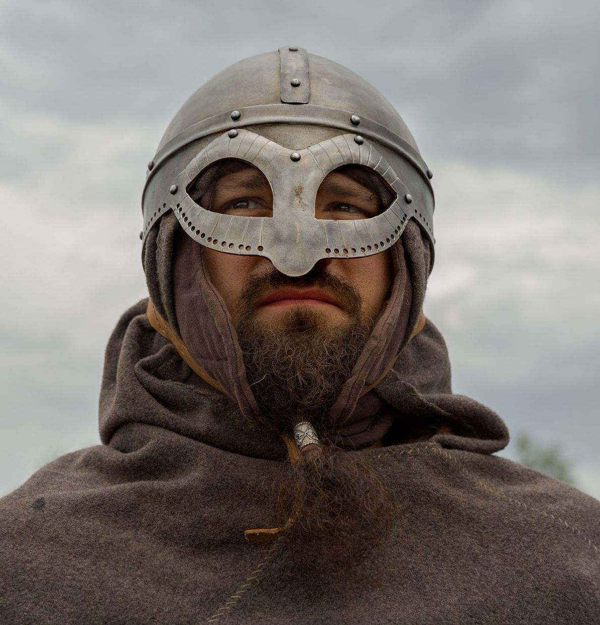 Concealed in iron helmets, chain mail, and leather cuirasses, Viking re-enactors make a formidable impression, revealing ...