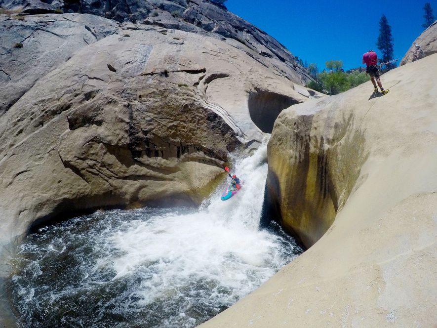 An adventurer takes a plunge over one of the bowl-like features of the Seven Teacups waterfall.