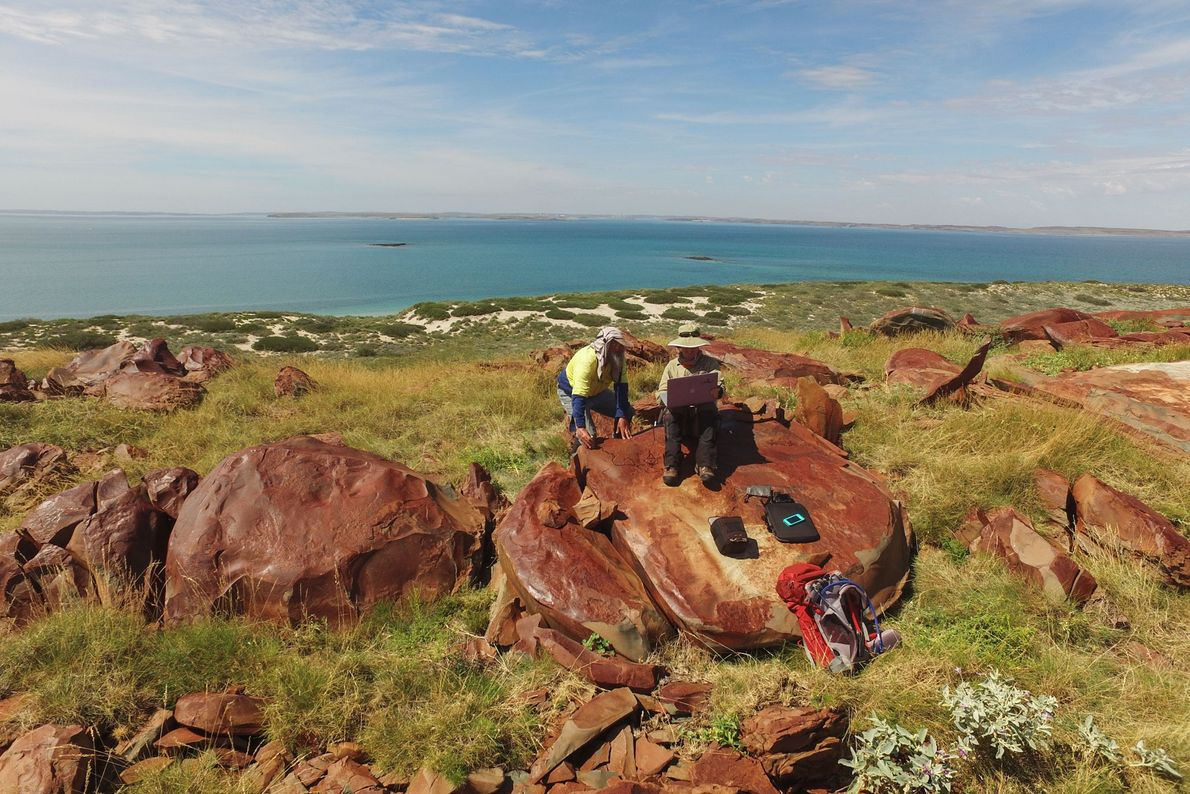 Archaeologists record the Connecticut inscriptions on Rosemary Island in western Australia's Dampier Archipelago. Rock art in ...