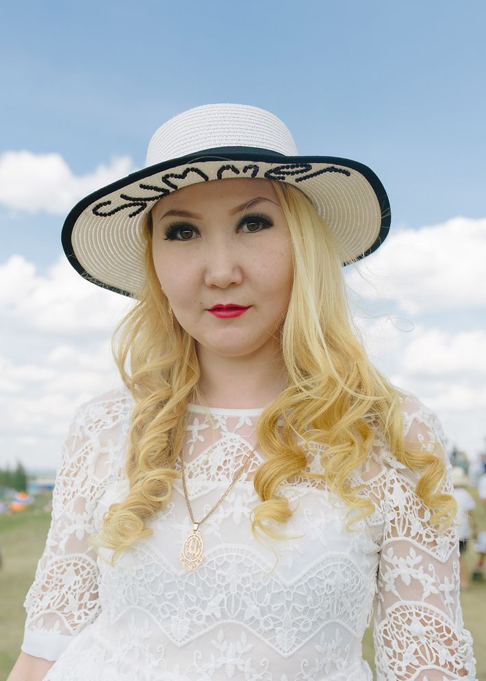 """A Yakut woman's hat reads """"summer"""" in English. Though Yakutia is famous for its record-breaking winters, ..."""